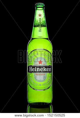 LONDON,UK -OCTOBER 17 2016: Bottle of Heineken Lager Beer on black background. Heineken is the flagship product of Heineken International