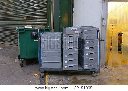 Shipping Crates in Delivery Cart at Back Entrance