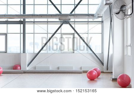 Place for aerobic exercises. Close up of a large bright well equipped sports hall for fitness training