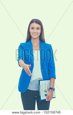 Business woman with arm extended for a handshake.
