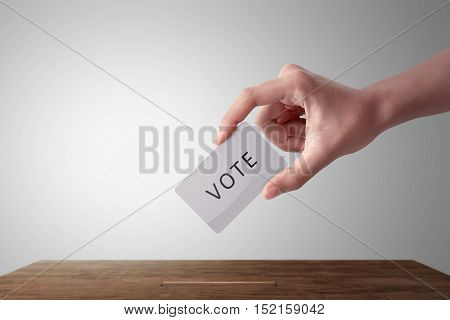 Person Hand Giving His Vote In A Ballot Box