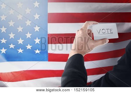 Businessman Holding Paper With 'vote' Writing