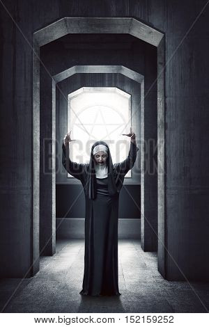 Young Evil Asian Woman Nun Standing With White Pentagram