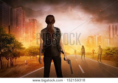 Asian Woman With Vest And Gun