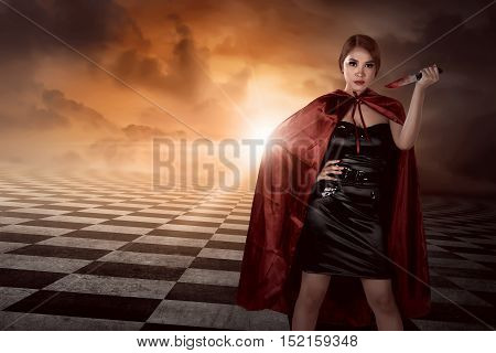 Witch Woman With Black Costume Wearing Cloak Hold Knife