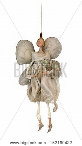 Fairy with wings New Year and Christmas tree decoration isolated on white background. Old decorative doll. Christmas holiday traditions. Photography of fairy for collage