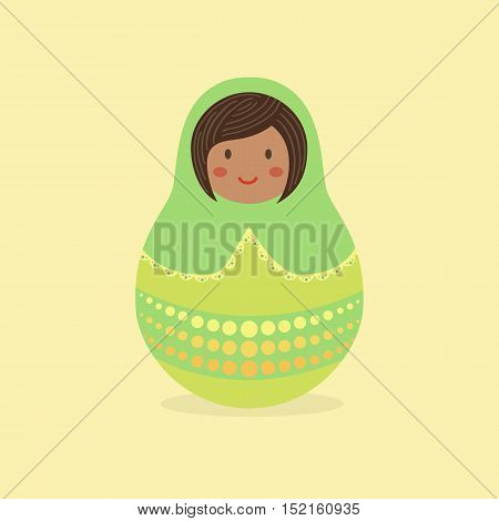 Cute Russian Doll with Green hood and costume on brown background.
