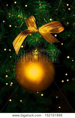 Golden Christmas ornament hanging. Christmas tree and Christmas decoration.