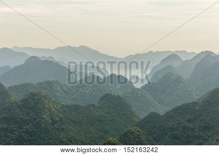 BAC SON, VIETNAM - April 17: Sunrise in mist in Bac Son valley, Lang Son, Vietnam