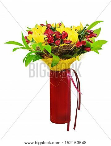 Colorful flower bouquet arrangement centerpiece in red vase isolated on white background. Closeup.