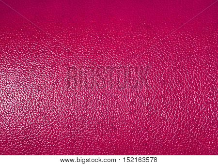 Surface of pink leatherette texture as background
