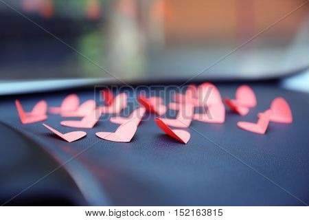 Paper hearts on car dashboard