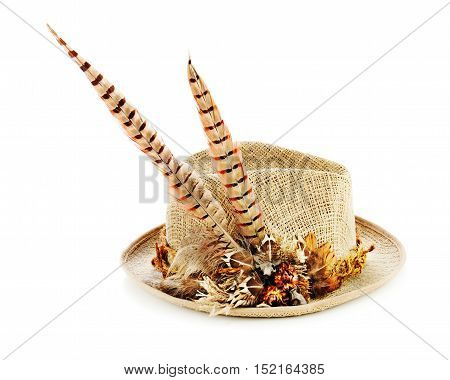 Hunting hat with pheasant feathers isolated on white. Closeup.