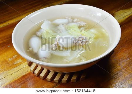 boiled minced pork stuffed squid with Chinese cabbage hot soup in bowl