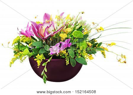 Bouquet from orchids and lilies in vase isolated on white background. Closeup.