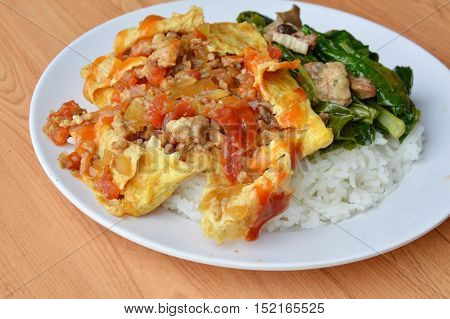 stuffed omelet and stir fried Chinese cabbage with chicken entrails on rice