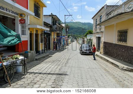 Antigua, Guatemala - June 16, 2011: Cobblestone streets of Antigua, Guatemala in summer with a blue sky above. Editorial use only