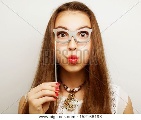 Party image. Playful young women holding a party glasses. Ready for good time.