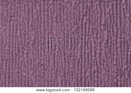 Purple fluffy background of soft fleecy cloth. Texture of textile closeup.