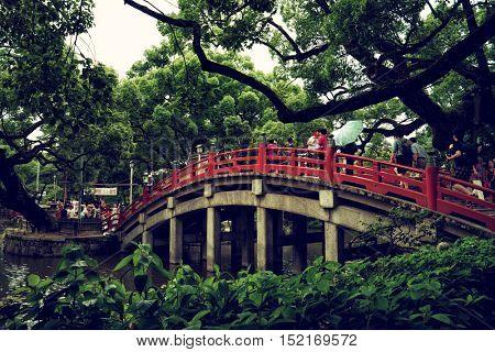 Dazaifu - July 2016: Tourist walking on bridge at Dazaifu Tenmangu Shrine.