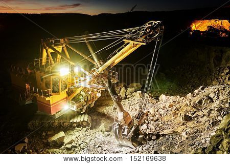 Mining construction industry. Excavator digging granite or ore in quarry