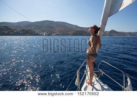 HYDRA, GREECE - OCT 4, 2016: Sailors participate in sailing regatta 16th Ellada Autumn 2016 among Greek island group in the Aegean Sea, in Cyclades and Saronic Gulf.