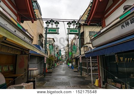Tokyo Japan - Aug 29 2016: side street with local souvenir shops and cafes near Senso-ji temple Asakusa district. Small streets in Tokyo do not have names