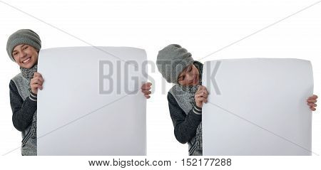 Set of cute teenager boy in gray sweater, hat and scarf holding paper bill board over white isolated background, half body