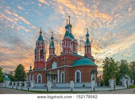 Russian orthodox church over burning sunset sky