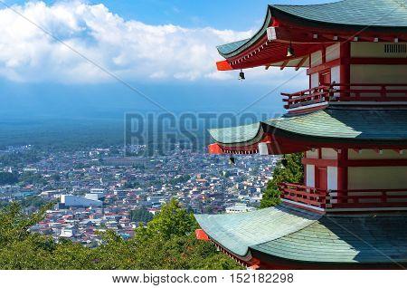 Chureito Pagoda With Fujiyoshida City On The Background