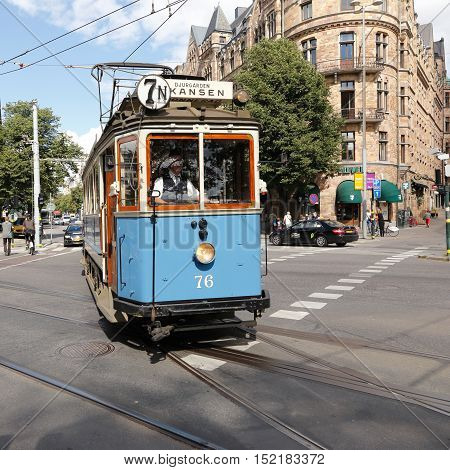 Stockholm, Sweden - August 13, 2013: A blue museum tram route between Norrmalmstorg and Skansen at Nybroplan.