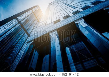 low angle view of modern metallic skyscrapers,blue toned,suzhou,china.