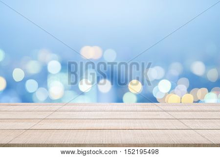 Beige wood table top panel on blue sky blurred background use for display products or design element in Christmas party or New Year holiday concept