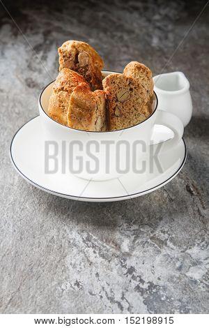 Traditional Italian Food. Cantuccini Cookies In White Mug. Gray