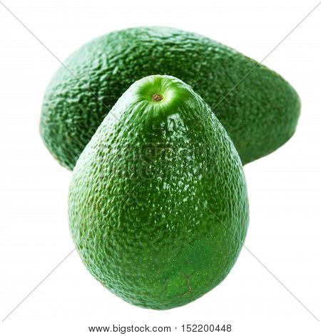 Whole ripe Avocado isolated on white background. Two Fresh green Avocado fruits macro