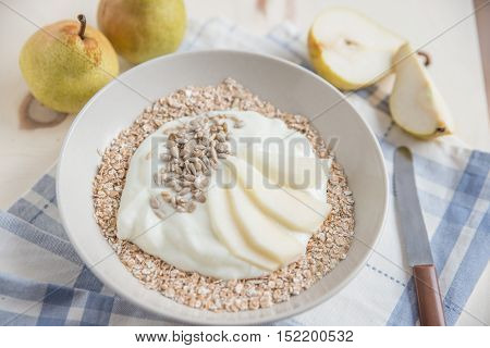 yogurt with fresh fruit, seeds and granola