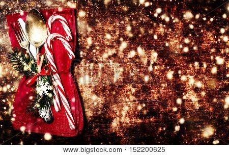Christmas table place setting with christmas ornaments and copy space for greeting text