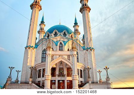 the entrance to the Qolsharif (Kul Sharif) Mosque in the Kazan Kremlin on which is written the name in the Tatar language. Sunset. Tatarstan Russia