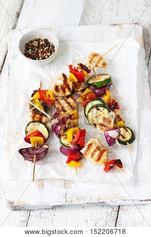 Grilled chicken skewers or shashlik with grilled vegetables and pepper