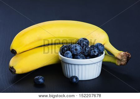 Two bananas and heap of huckleberries