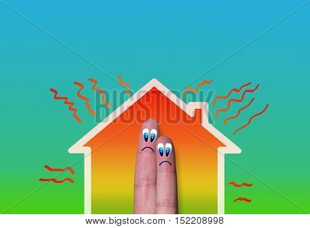 house with high heat loss illustration where two fingers inside on green background