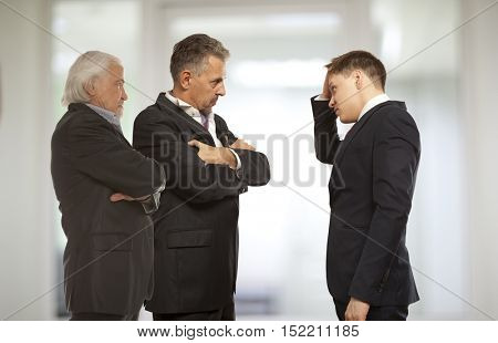 Business competition, conflict concept. Three businessman are trying to come to an agreement
