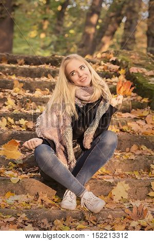 happy girl in autumn park smiling, toned image