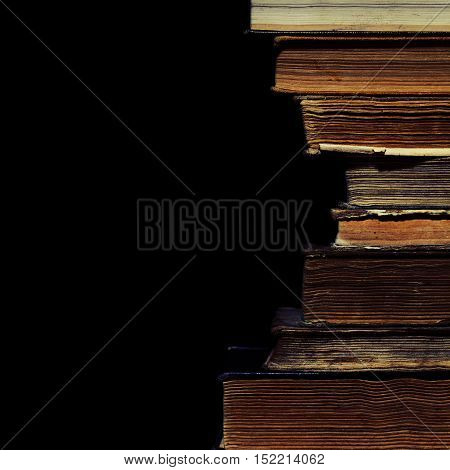 Set of old book on the black background.