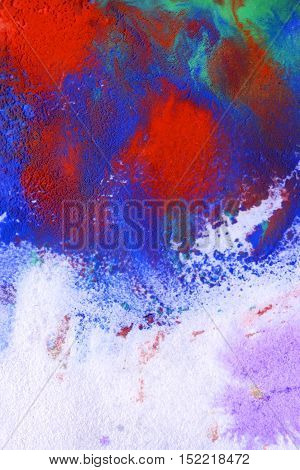 blue and red stains on a white surface