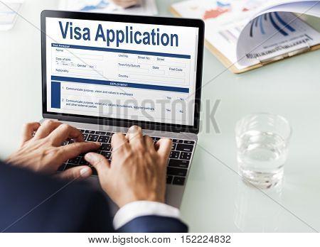 Business man filling out online visa application