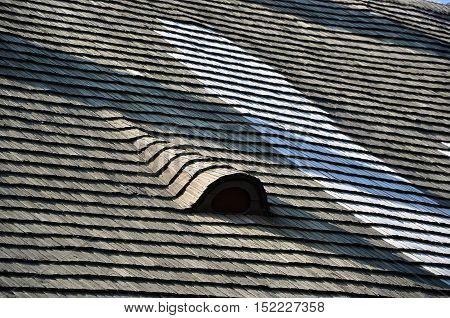 Old Repaired Thatch Roof With Small Roof Window