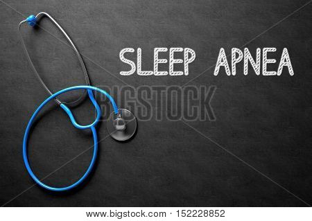 Medical Concept: Black Chalkboard with Handwritten Medical Concept - Sleep Apnea with Blue Stethoscope. Top View. Medical Concept: Sleep Apnea - Medical Concept on Black Chalkboard. 3D Rendering.