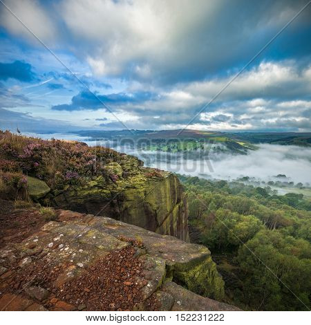 View from the Top of Rocky Hill with Heather Flowers and Morning Mist