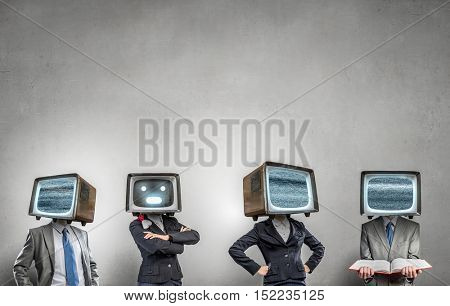 People with TV instead of head . Mixed media